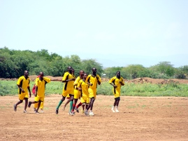 A soccer game held during the afternoon.