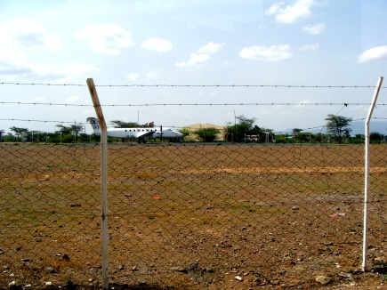 A view from the outside of the airport, which resets only a few yards from the refugee camp.